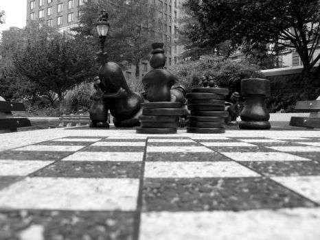 Sculptures playing Chess by sek2001