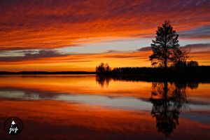 Red horizon over Lake in Finlands north Karelia by vojtikk