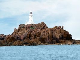 Lighthouse and Rocks by cemacStock