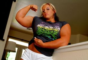Angry muscle women flexes her guns by musclewomen