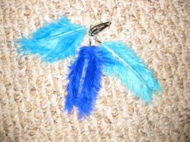 Blue feather hair clip by wolffang56