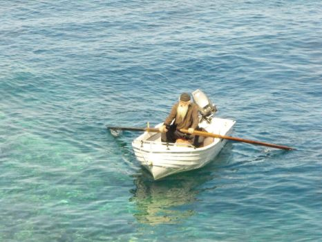 Monk in a Boat by TalusPhotography