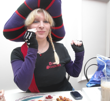 Eating grapes in the Frollo hat by ChristineFrollophile