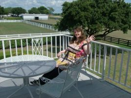 Sitting on J.R.'s Balcony At Southfork Ranch by Millerkatrina28