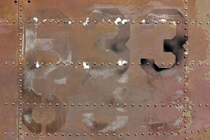 Faded Numbers on Metal by GrungeTextures