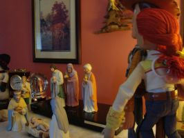 Woody and Jessie looking at baby Jesus by spidyphan2