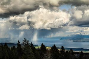 Rain over Lake Geneva by cwaddell
