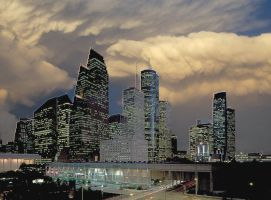 Exc-1 Clouds Over Cityscape by EclipsisStudios