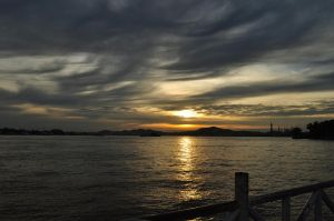 sunset at mahakam river by Greywind89