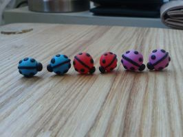 Blue, red and pink ladybirds by MeticulousBlue