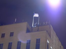 Flag pole atop a roof by CrazypersonA4
