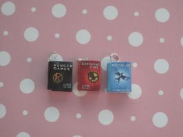 The Hunger Games book charms by ichigoluv