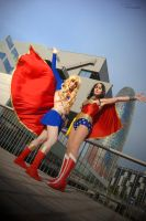 Super Girl and Wonder Woman by AliciaMigueles