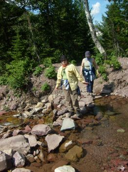 Mom and Me crossing creek by Aredith