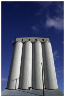 Blue silos by Ticklemetimebomb