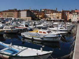 Boats in the Rovinj town port by raff34