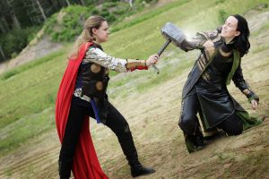 Thor: Lady Thor vs. Loki by MirroredSilhouettes