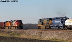 Pan Am Railway passing a Warbonnet Oil Train by EternalFlame1891
