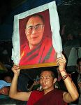 Tibetan Buddhist Monk Holding Dalai Lama Portrait by crypticfragments