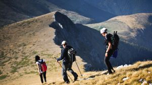 Hikers going downhill by hypertech