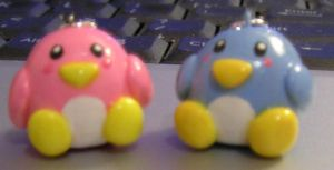 pink and blue penguins by kneazlegurl125