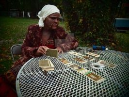 Old Gypsy Woman Reading Tarot Cards by Fullmoon-rose
