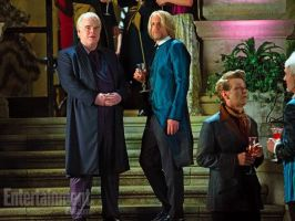 Haymitch and Plutarch by OrigenTheLoner