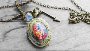 Fire Opal Oval Glass Cabochon Locket Necklace by crystaland