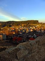 Village skyline below the castle at sundown by patrickjobst