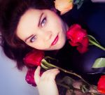 Covered by roses by DameTenebra
