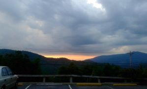 Cloudy Mountain Sunset by Charlotte-Nikki