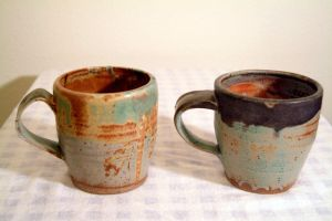 rusted mugs by Recycled-Oxygen