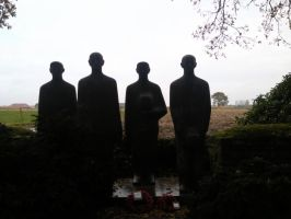4 iron men on the graveyard... by furiousflamewolf
