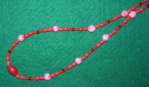 Red swirl clay beads by ladytech