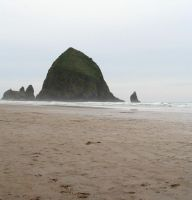 Haystack at Cannon Beach by KelbelleStock
