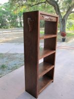 Bookshelf with carved wings. by flintlockprivateer