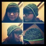 Crocheted green and black hat by ownpersonalhell