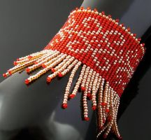 Bead loomed bracelet with fringe by CatsWire