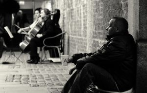 Beggar and Cellists by Petach123