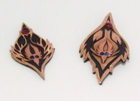 Rose bronze and Steel blood elf pendants by Peaceofshine
