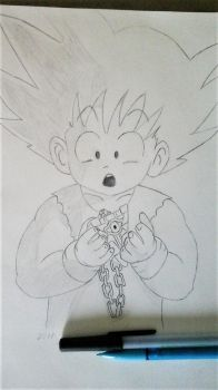 DBZ-Goku and the millennium Puzzle by TheBuuman