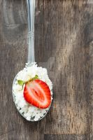 Strawberry and cottage cheese in spoon by BeKaphoto