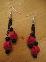 skull and chain earrings by pnuewave