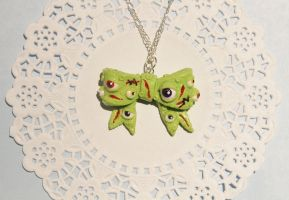 Polymer Clay Zombified Eye Bow Pendant by CharmStop