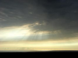 Setting Sun Through Clouds by Synaptica