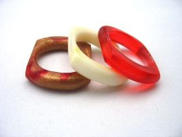 Red, gold white resin ring set by TopazTurtle