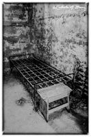 Abandoned Penitentiary - Bed With Table by cjheery