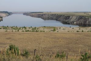 The opencast mine and the lake by utico