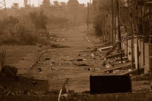 Trash in the road by Bettsphotography