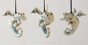 Pearly White hanging dragon by LitefootsLilBestiary